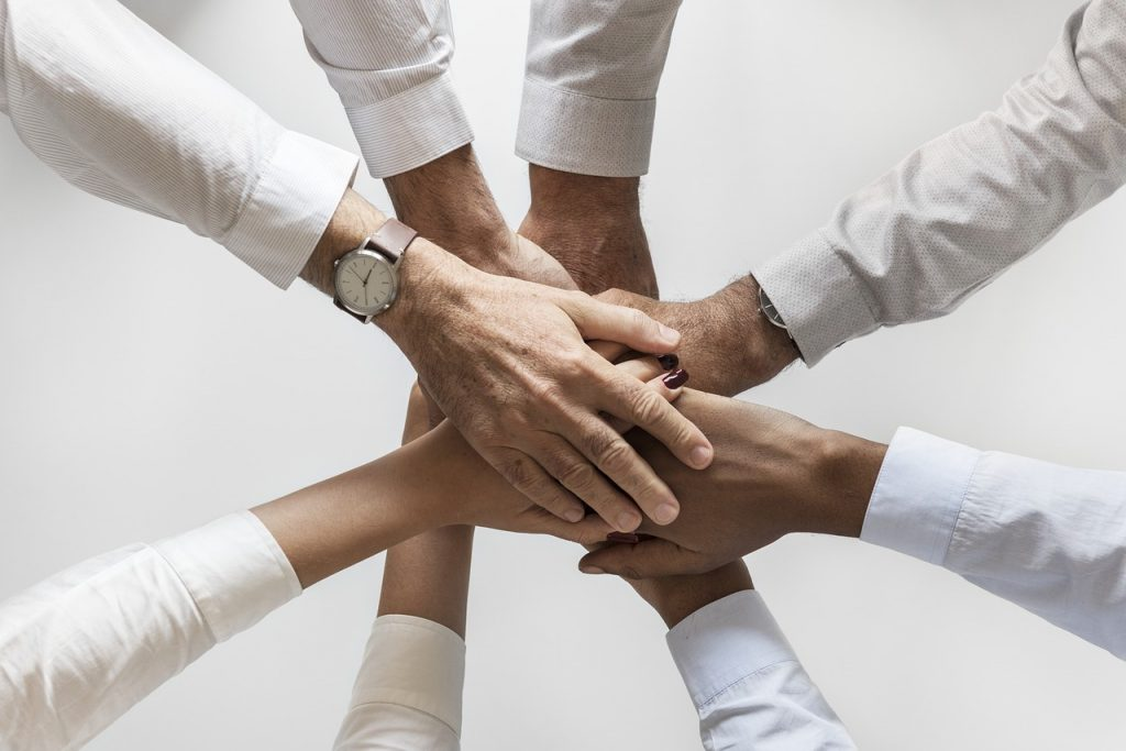 Photo of people's hands in a group